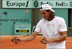 Spain's Rafael Nadal, exercising at the French Open, is trying to get voted onto the ATP Tour's Players' Council. Nadal has been a persistent critic regarding the compressed clay-court schedule.
