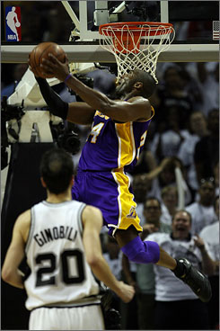 Lakers guard Kobe Bryant rises for a reverse dunk as Ginobili can only watch in the third quarter of Game 4 of the Western Conference finals Tuesday in San Antonio. Bryant finished 28 points and 10 boards in 41 minutes.