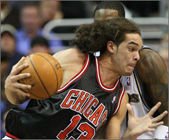Chicago Bulls forward Joakim Noah drives to the hoop during a game in Washington last December. The ex-University of Florida star has agreed to settle his case involving alleged drug possession.