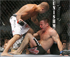 BJ Penn, left, knocks down Sean Sherk on Saturday en route to a UFC victory in Las Vegas.