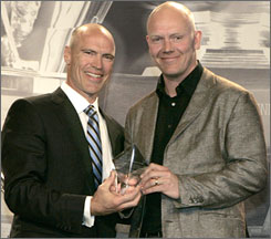 Hockey great Mark Messier, left, presents Maple Leafs captain Mats Sundin with the Mark Messier Leadership Award at a ceremony in Pittsburgh.