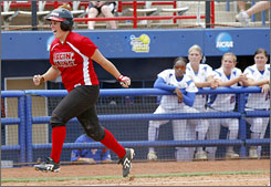 Holly Tankersley runs past the Florida dugout after knocking out the game-winning home run in the top of the eighth inning, stunning the top-seeded Gators at the NCAA Women's College World Series.