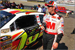 Greg Biffle has reason to smile as he stands by his No. 16 Ford during qualifying at Dover International Speedway.