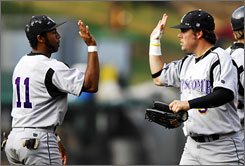 Lipscomb's Shane Simpson, left, and Channing Brown exchange high-fives after they upset Georgia 10-7 at the Athens Regional.