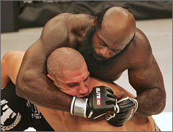Kimbo Slice, top, defeated James Thompson on Saturday with superior striking after being dominated while fighting off his feet.