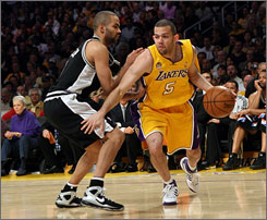 "Lakers guard Jordan Farmar drives around the San Antonio Spurs' Tony Parker in the Western Conference Finals. Farmar, who Kobe Bryant says ""can do more than we even ask him to,"" has matured a great deal since his collegiate days at UCLA."
