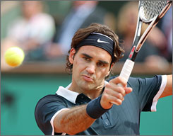 Roger Federer cruised into the quarterfinals at the French Open with a straight-set victory over Julien Benneteau on Monday.