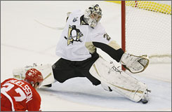 """Penguins goalie Marc-Andre Fleury, whose surname is French for """"flower,"""" makes a save during Game 5 of the Stanley Cup Finals."""