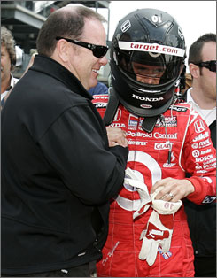 Chip Ganassi congratulates his driver Dan Wheldon after qualifying for the Indianapolis 500 at the Indianapolis Motor Speedway on May 10, 2008.