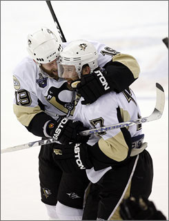 Petr Sykora (17) celebrates with teammate Ryan Whitney after scoring the game-winning goal in the third overtime to help Pittsburgh bring the Stanley Cup Finals back to Mellon Arena for Game 6 on Wednesday.
