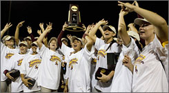 Arizona State celebrates their 11-0 win over Texas A&M to clinch the NCAA softball championship.