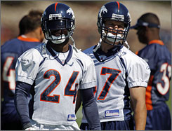 "Champ Bailey, left, is itching for the Broncos' return to the playoffs this season. ""I would love to win that defensive player of the year award, but those awards only mean so much if you don't have a ring,"" he said. ""The Super Bowl, that's my goal."""