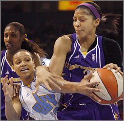 Candace Parker, right, fights for a rebound with the Chicago Sky's Armintie Price. Parker, who fouled out, finished with 12 points and seven rebounds.