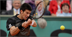 Novak Djokovic won Tuesday setting up his his anticipated matchup against clay-court master, Rafael Nadal.