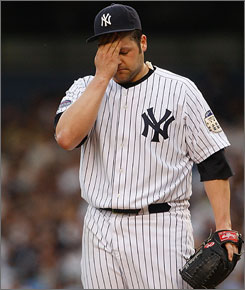 New York's Joba Chamberlain wipes his forehead against the Blue Jays. Chamberlain lasted less than 3 innings in his first start as the Yankees were pounded by the Blue Jays.