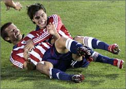 Jorge Flores, right, celebrates with teammate Jesse Marsch after Marsch's goal May 24 against Colorado. The two players have been Chivas USA's unlikely goal-scoring leaders in recent weeks.