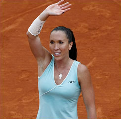 Jelena Jankovic waves to the crowd after winning her quarterfinal matchup on Tuesday. After the match, she headed home to Serbia to get some treatment for her injuries before facing Ana Ivanovic in the semifinals.