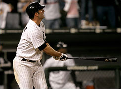 Chicago White Sox's Paul Konerko watches his seventh homer of the year sail into the left-field bleachers for a walk-off, 6-4 victory over the Kansas City Royals.