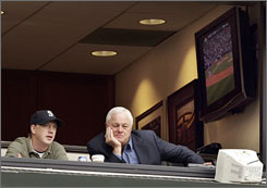 Seattle Mariners president Chuck Armstrong, right, watches the team suffer another loss, this time to the Los Angeles Angels, 5-4. Armstrong berated members of the coaching staff earlier that morning, but it did not change the Mariners' most familiar outcome this season.