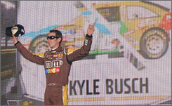 Kyle Busch, a winner in all three of NASCAR's top series this season, offers a wave at the All-Star Race before taking a facetious bow to the fans.