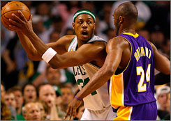 Paul Pierce, shown backing down Kobe Bryant, sparked the Celtics in the third quarter of their Game 1 defeat of the Lakers. Pierce scored 15 of his 22 points in the period despite leaving briefly with a knee sprain.