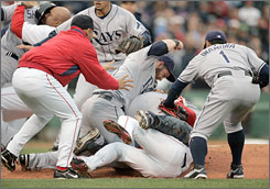 Red Sox and Rays players cleared the benches for a second-inning brawl when Boston batter Coco Crisp charged the mound after Tampa Bay's James Shields hit him with a pitch.