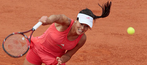 Ana Ivanovic rallied after losing an early lead to beat Jelena Jankovic in three sets and advance to the championship match at Roland Garros.