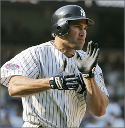 Johnny Damon collected a career-high six hits, including the game-winner, in Saturday's 12-11 win over the Royals.