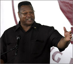 Larry Holmes delivers his induction speech at the International Boxing Hall of Fame in Canastota, N.Y. Holmes reigned as the heavyweight champion from 1978-85, defending his crown 20 times.