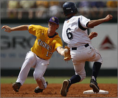LSU shortstop D.J. LeMaheiu tags out UC Irvine's Ben Orloff during a steal attempt. LSU rallied in the top of the ninth to force a decisive third game.