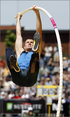 Brad Walker broke an eight-year-old American record in the pole vault after clearing 19 feet, 9 inches at the Prefontaine Classic.