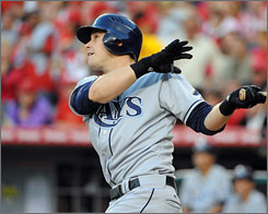 The Rays' Evan Longoria hits a solo home run in the first inning of Tampa Bay's 13-4 victory over the Angels in Anaheim, Calif.