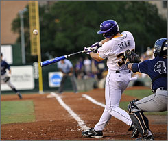 LSU's Blake Dean makes contact for a double during the bottom of the second inning of an NCAA Super Regional baseball game against UC Irvine. Seven Tiger home runs  and 24 total hits  led to a 21-7 victory.