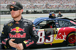 Brian Vickers, driver of the  No. 83 Red Bull Toyota, waits for the start of the NASCAR Sprint Cup Series Pocono 500 on June 8. Not able to pull off the victory, Vickers settled for a second-place finish.
