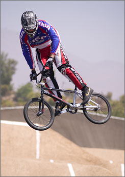 BMX racer Bubba Harris has put off surgery on a severely dislocated left ankle in order to compete in the Beijing Olympics.