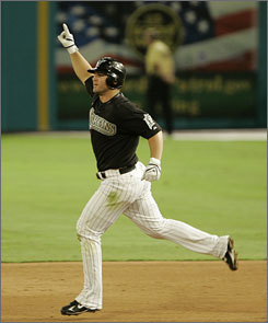 Dan Uggla rounds the bases after slugging out a game-ending grand slam that helped the Marlins beat the Phillies at Dolphin Stadium.