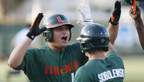 Miami's Yonder Alonso celebrates his two-run homer with teammate Mark Sobolewski against Arizona in the first inning of a Super Regional game on June 8. The No. 1-ranked Hurricanes will now take on Georgia in the College World Series.
