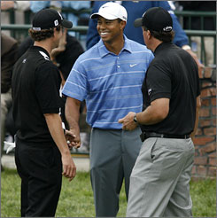 Tiger Woods, middle, shares a laugh with Adam Scott, left, and Phil Mickelson before starting their first round at the U.S. Open.