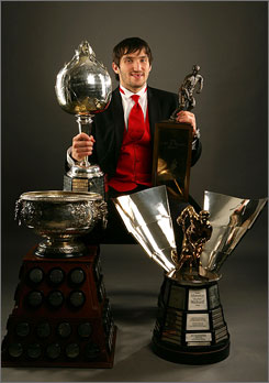 Washington's Alex Ovechkin poses with the four major trophies he won at the NHL awards show on Thursday night, including the league's MVP.