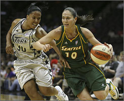 The Silver Stars' Helen Darling guards Seattle's Sue Bird in the first half of San Antonio's 74-69 home win.