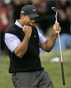 Tiger Woods celebrates after making an eagle putt on the 13th hole during the third round of the U.S. Open championship Saturday at Torrey Pines South Course in San Diego.