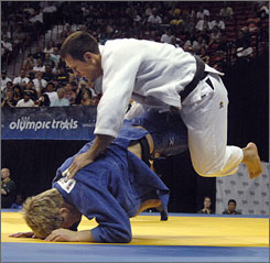 Ryan Reser, right, and Nick Delpopolo compete in the 160.6-pound category of the U.S. Olympic judo trials in Las Vegas.
