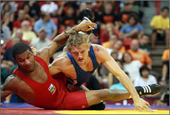 Ben Askren booked his ticket to Beijing after defeating Tyrone Lewis in the 163-pound freestyle wrestling final in Las Vegas.