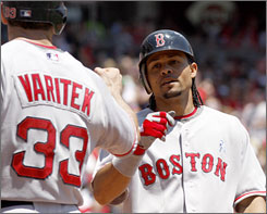 Coco Crisp is congratulated by Jason Varitek after hitting a two-run homer in the second inning of Boston's 9-0 victory over Cincinnati on Sunday.
