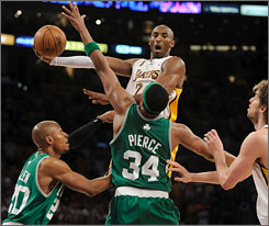 Lakers star Kobe Bryant glides through the lane against pressure from Boston's Paul Pierce and Ray Allen before making a pass. Bryant finished with 25 points. Pierce had 38.