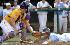 North Carolina's Tim Fedroff scores at home plate past the tag by LSU catcher Micah Gibbs. The Tar Heels won 8-4.