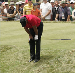 Tiger Woods was forced to stop walking to his ball after his tee shot on the second hole.