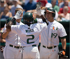 Miami second baseman Jemile Weeks comes home on his two-run blast in the third inning as the Hurricanes knocked ACC rival Florida State out of the College World Series on Monday with a 7-5 win.