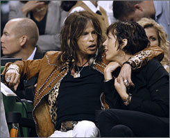 Aerosmith frontman Steven Tyler, left, was one of many celebrities who were in attendance at Game 6 of the NBA Finals at TD Banknorth Garden in Boston.
