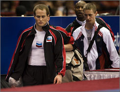 2004 Olympic gold medalist Paul Hamm, left, fractured his hand at the 2008 USA Gymnastics Visa Championships on May 22. Hamm's injury will make it tougher for prospective Olympians trying out because it is unclear whether Hamm will be healthy enough to compete in Beijing, or whether he will forfeit his spot.